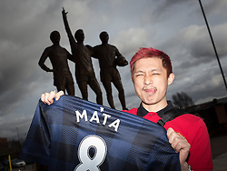 © Licensed to London News Pictures . 27/01/2014 . Manchester , UK . HUNG-JUI LIN (27, tourist from Taiwan) poses with his new shirt in front of the United Trilogy statue . Fans with new MATA 8 shirts in front of Old Trafford Football Ground as it's announced that Spaniard Juan Mata ( Juan Manuel Mata García ) has signed for Manchester United  . Photo credit : Joel Goodman/LNP