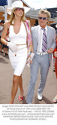 Singer ROD STEWART and MISS PENNY LANCASTER, at Royal Ascot on 19th June 2002.PBD 139