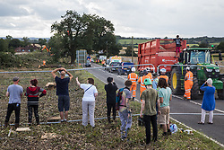 Anti-HS2 activists observe HS2 workers preparing to fell a mature oak tree after a fellow activist had occupied the tree alongside the Fosse Way in order to try to protect it from works in connection with the HS2 high-speed rail link on 24th August 2020 in Offchurch, United Kingdom. The controversial HS2 infrastructure project is currently expected to cost £106bn and will destroy or significantly impact many irreplaceable natural habitats, including 108 ancient woodlands.