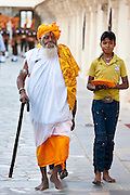Hindu priest at Holi festival of 76th Maharana of Mewar, Mewar of Udaipur, at the City Palace, Rajasthan, India