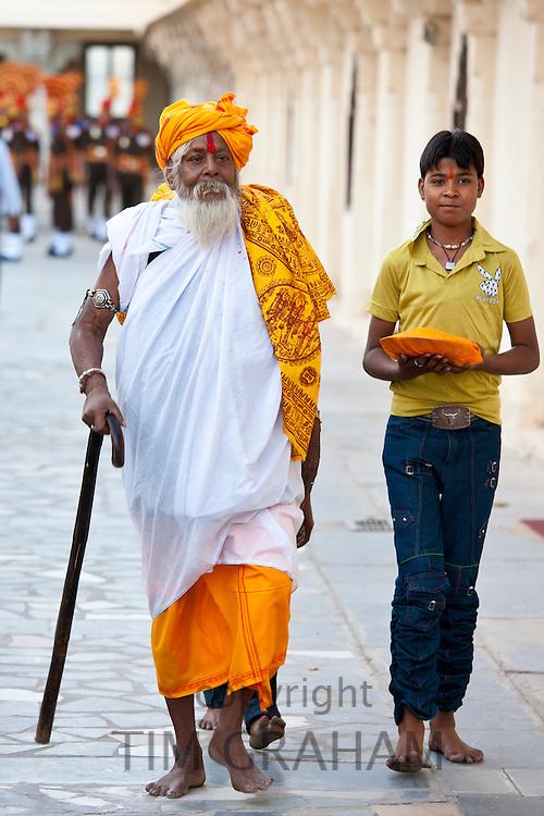 Hindu priest at Holi festival of 76th Maharana of Mewar, Mewar of Udaipur, at the City Palace, Rajasthan, India