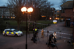 © Licensed to London News Pictures. 06/03/2018. Salisbury, UK. Media gather near a police tent covering a park bench near the Maltings shopping centre in Salisbury where former Russian spy Sergei Skripal and a woman in her 30s were taken ill with suspected poisoning. The couple where found unconscious on bench in Salisbury shopping centre. Specialist units have been called in to deal with any possible contamination. Photo credit: Ben Cawthra/LNP