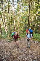 Backpackers take a break on Pine Ridge Trail, Big Sur, California.