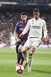 March 2, 2019 - Madrid, Madrid, Spain - Luis Suarez (forward; Barcelona), Raphael Varane (defender; Real Madrid) in action during La Liga match between Real Madrid and FC Barcelona at Santiago Bernabeu Stadium on March 3, 2019 in Madrid, Spain (Credit Image: © Jack Abuin/ZUMA Wire)