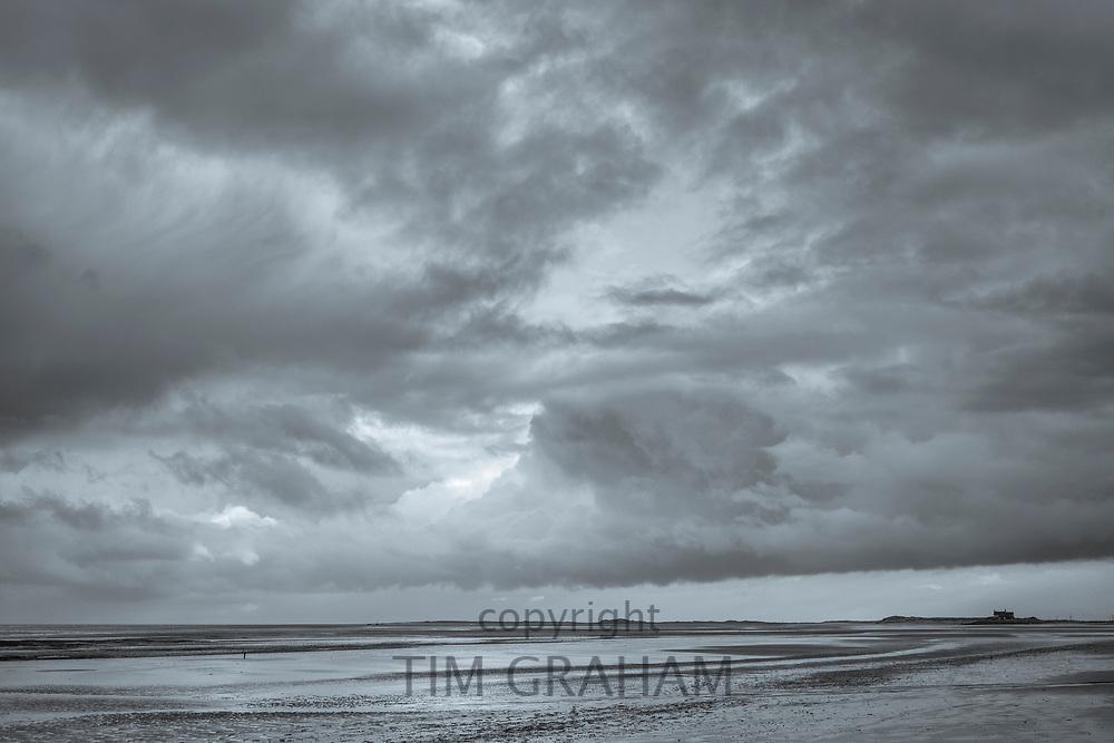 Cloudy skyscene and Norfolk coastal scene at Titchwell, North Norfolk, England, UK
