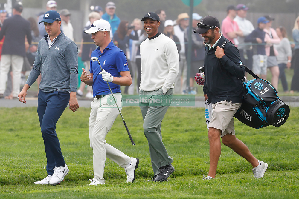 June 12, 2019 - Pebble Beach, CA, U.S. - PEBBLE BEACH, CA - JUNE 12: From left to right PGA golfers Jordan Spieth and Justin Thomas and Tiger Woods walk the 16th hole during a practice round for the 2019 US Open on June 12, 2019, at Pebble Beach Golf Links in Pebble Beach, CA. (Photo by Brian Spurlock/Icon Sportswire) (Credit Image: © Brian Spurlock/Icon SMI via ZUMA Press)
