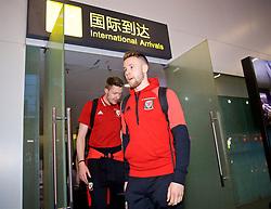 NANNING, CHINA - Monday, March 19, 2018: Wales' Chris Gunter and goalkeeper Wayne Hennessey arrive at Nanning International Airport for the 2018 Gree China Cup International Football Championship. (Pic by David Rawcliffe/Propaganda)