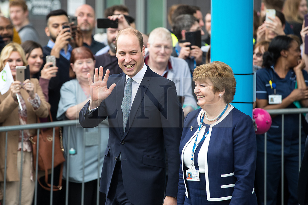 © Licensed to London News Pictures . 02/06/2017 . Manchester , UK . The Duke of Cambridge , Prince William , leaves Royal Manchester Children's Hospital after meeting patients affected by the murderous bomb attack at an Ariana Grande gig at Manchester Arena on Monday 22nd May . Photo credit : Joel Goodman/LNP