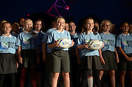 A school choir pose with Official Rugby World Cup match balls. RWC 2015, Coca Cola London Eye launch for the Rugby World cup event  in London on Tuesday 15th Sept  2015.<br /> pic by John Patrick Fletcher, Andrew Orchard sports photography.