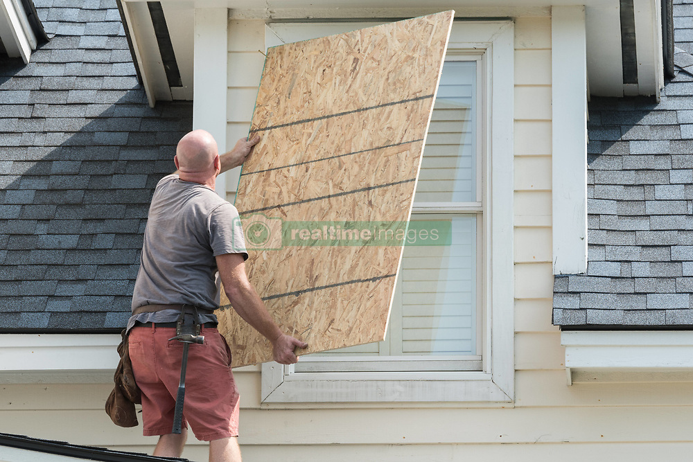 September 7, 2017 - Isle Of Palms, SC, United States - A carpenter covers windows with plywood in preparation for Hurricane Irma in the beach community of Isle of Palms September 7, 2017 in Isle of Palms, South Carolina. Imra is packing winds of 185-mph making it the strongest hurricane ever recorded in the Atlantic Ocean and has already caused devastation in the Caribbean. (Credit Image: © Richard Ellis via ZUMA Wire)