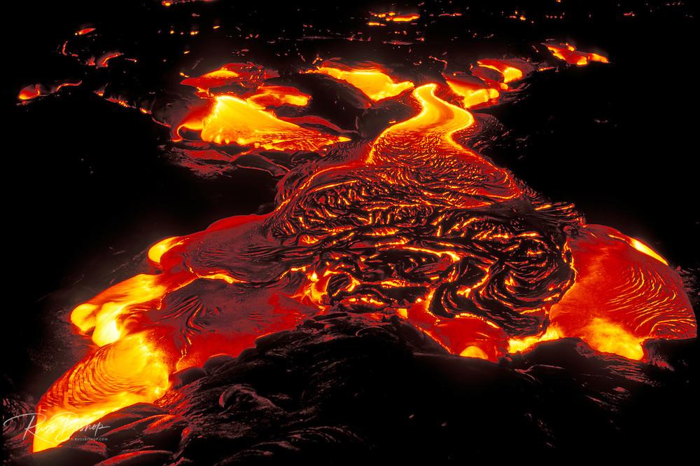 Surface lava flowing at night, Hawaii Volcanoes National Park, The Big Island, Hawaii