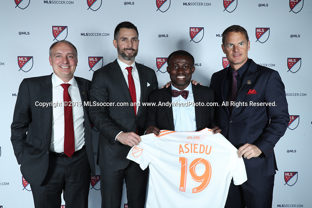 CHICAGO, IL - JANUARY 11: Anderson Asiedu was taken with the 24th overall pick by Atlanta United FC. With team president Darren Eales (left), technical director Carlos Bocanegra (second from left), and head coach Frank de Boer (right). The MLS SuperDraft 2019 presented by adidas was held on January 11, 2019 at McCormick Place in Chicago, IL.