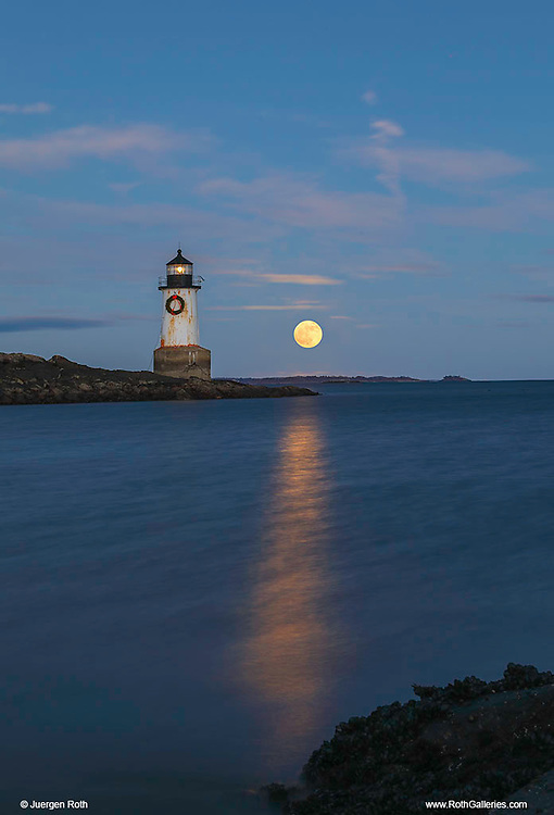 New England lighthouse photography of Fort Pickering Light at cold moon rise. This iconic Massachusetts lighthouse is located at Winter Island Park in Salem Massachusetts.<br /> <br /> Picturesque New England lighthouse photography image are available as museum quality photography prints, canvas prints, acrylic prints, wood prints or metal prints. Fine art prints may be framed and matted to the individual liking and interior design decorating needs:<br /> <br /> https://juergen-roth.pixels.com/featured/full-cold-moon-rise-across-fort-pickering-light-juergen-roth.html<br /> <br /> Good light and happy photo making!<br /> <br /> My best,<br /> <br /> Juergen<br /> Photo Prints: http://www.rothgalleries.com<br /> Photo Blog: http://whereintheworldisjuergen.blogspot.com<br /> Instagram: https://www.instagram.com/rothgalleries<br /> Twitter: https://twitter.com/naturefineart<br /> Facebook: https://www.facebook.com/naturefineart