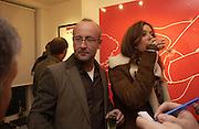 """Sebastian Sainsbury and Carmen Dudley.  """"Hold""""  exhibition of work by Natasha Law at Eleven.  January 12 2006. London. ONE TIME USE ONLY - DO NOT ARCHIVE  © Copyright Photograph by Dafydd Jones 66 Stockwell Park Rd. London SW9 0DA Tel 020 7733 0108 www.dafjones.com"""