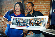 SHOT 12/10/17 1:16:55 PM - Former Buffalo Bills wide receiver and Hall of Fame player Andre Reed signs autographs and meets with fans at LoDo's Bar and Grill in Denver, Co. as the Buffalo Bills played the Indianapolis Colts that Sunday. Reed played wide receiver in the National Football League for 16 seasons, 15 with the Buffalo Bills and one with the Washington Redskins. (Photo by Marc Piscotty / © 2017)