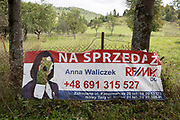 "A defaced election poster for the Polish political candidate Anna Waliczek, on 20th September 2019, in Biala Woda, Jaworki, near Szczawnica, Malopolska, Poland. Poland's parliamentary elections will be held on 13 October 2019 when all 460 members of the Sejm and 100 senators will be elected. The Sejm of the Republic of Poland is the lower house of the Polish parliament. It consists of 460 deputies elected by universal ballot and is presided over by a speaker called the ""Marshal of the Sejm of the Republic of Poland"""