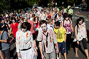 """Stoke Newington Zombie-a-thon. Hundreds of people joined together in protest in North London to demonstrate against the planned opening of a large Sainsbury's supermarket. Dressed up as zombies the protesters were making the point that they should keep local shops in the area and not have the high street ruined by large chains. The action by Stokey Local says: """"In Stoke Newington, even the dead are rising up to say 'no' to a proposed Sainsbury's development."""" Walking slowly as if in a zombie film the march culminated in passing a Sainsbury's Local supermarket on the High Street. In the middle of June it was announced that a development is being planned for Wilmer Place, just beside Abney Park Cemetery on the corner of Church Street and the High Street – right in the heart of Stoke Newington. The proposed development comprises a large Sainsbury's supermarket and 44 homes and has significant implications for thediversity of the local economy, local employment, transport & traffic, noise and safety and local heritage."""