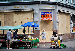 © Licensed to London News Pictures. 25/08/2016. London, UK. A business premises boarded up in Notting Hill ahead of the annual Notting Hill Carnival which starts this bank holiday weekend. Photo credit: Ben Cawthra/LNP