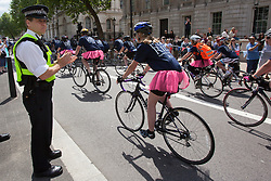 © licensed to London News Pictures. London, UK 02/06/2013. A police officer applauding Help for Heroes volunteers and wounded soldiers cycling for the annual Hero Ride fundraising event in central London on Sunday, 2 June 2013 . Photo credit: Tolga Akmen/LNP