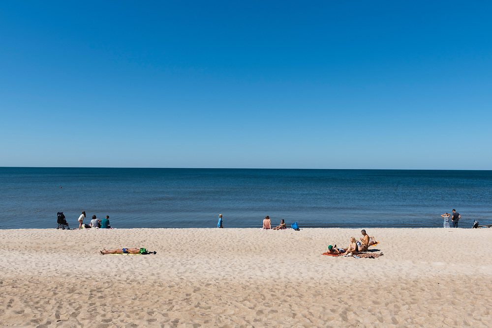 Curonian Spit, Lithuania - August 18, 2015: People enjoy the beach on a summer day on the Curonian Spit between Juodkrantė and Nida.