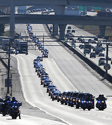 December 18, 2018 - Atlanta, GA, USA - A DeKalb County public safety procession from public safety headquarters stretching well over a mile in length travels down I-285 West for the funeral service of officer Edgar Isidro Flores, 24 of Decatur to All Saints Catholic Church on Tuesday, Dec 18, 2018, in Dunwoody, Ga. Flores was shot and killed in DeKalb County in the line of duty last week. (Credit Image: © Curtis Compton/Atlanta Journal-Constitution/TNS via ZUMA Wire)