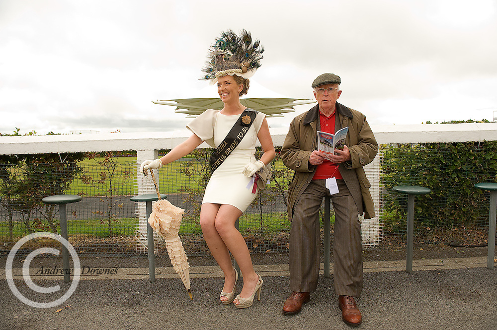 On her hen party in Galway for the weekend Keira O' Brien from Tralee in Kerry  spent yesterday at the Galway Races under the watchfull eye of 85 year old James Loftus from Templeboy in Co. Sligo . Photo:Andrew Downes