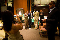 New York Giants' Plaxico Burress, in white, after receiving Tiffany's Supper Bowl Rings May 29, 2008. Photographer: Robert Caplin For The New York TImes..