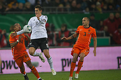 15.11.2011, Imtech Arena, Hamburg, GER, FSP, Deutschland (GER) vs Holland (NED), im Bild Miroslav Klose (GER #11 Rom) Nigel de Jong (NED #14 Manchester City)v Johnny Heitinga (NED #03 Everton FC(NED # // during the Match Gemany (GER) vs Netherland (NED) on 2011/11/15, Imtech Arena, Hamburg, Germany. EXPA Pictures © 2011, PhotoCredit: EXPA/ nph/ Kokenge..***** ATTENTION - OUT OF GER, CRO *****