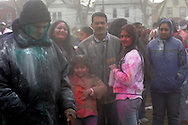 Indians celebrate the Spring holiday of Holi, by throwing colored powders and spraying colored water on each other to chase away the gray of winter. The festival took place on Liberty Ave, and most of the powder was thrown in Smoky Oval Park in Richmond Hill Queens...Photo by Nancy Siesel..