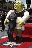 5/20/2010 Mike Myers leans against Shrek during Shrek's Walk of Fame ceremony