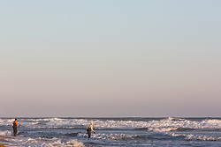 surf fishermen in the Atlantic Ocean at Ditch Plains in Montauk, NY