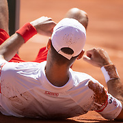 PARIS, FRANCE June 13.   Novak Djokovic of Serbia slips and falls during his match against Stefanos Tsitsipas of Greece on Court Philippe-Chatrier during the Men's Singles Final at the 2021 French Open Tennis Tournament at Roland Garros on June 13th 2021 in Paris, France. (Photo by Tim Clayton/Corbis via Getty Images)