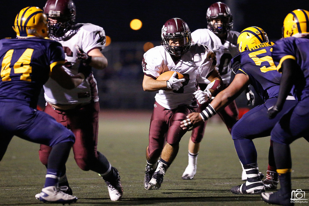 Piedmont Hills' running back Alex Flores (17) carries the ball during the CCS Division 1 playoff game against Milpitas at Milpitas High School in Milpitas, California, on November 29, 2013. No. 2 Milpitas beat No. 3 Piedmont Hills 45-0. (Stan Olszewski/SOSKIphoto)