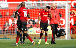 Manchester United's Jesse Lingard (second right) comes off after picking up an injury during the Premier League match at Old Trafford, Manchester.