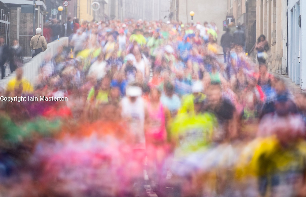 Edinburgh, Scotland, UK. 27 May, 2018. Runners make their way down the Royal Mile towards the Scottish Parliament Building at Holyrood during the Edinburgh Marathon 2018