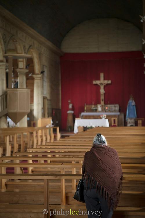 Woman in Chonchi Church on Chiloe Island, Chile