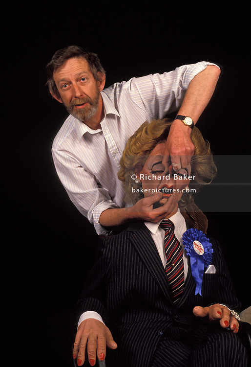 A portrait of the satirical puppet of Margaret Thatcher with Spitting with Spitting Image co-creator Peter Fluck and wears a blue Conservative rosette and For Hire sticker, on 20th March 1992, in London England. Peter Nigel Fluck is a caricaturist and one half of the partnership known as Fluck and Flaw (with Roger Law), creators of the satirical TV puppet show 'Spitting Image'.