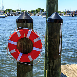 Annapolis, MD / USA - July 9, 2017: A bright red life preserver on the docks near the downtown area of Maryland's capital city.