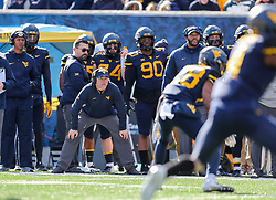Nov 10, 2018; Morgantown, WV, USA; West Virginia Mountaineers head coach Dana Holgorsen watches a play during the second quarter against the TCU Horned Frogs at Mountaineer Field at Milan Puskar Stadium. Mandatory Credit: Ben Queen-USA TODAY Sports