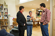 Marty Riker, right, talks with Bill Ferguson, left, and an unidentified supporter during the No On Measure E party at a private residence during the midterm election in Milpitas, California, on November 4, 2014. (Stan Olszewski/SOSKIphoto)