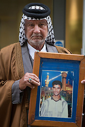 © licensed to London News Pictures. London, UK 18/03/2013. Iraqi witness Mizal Karim Al Sweady showing picture of his son Hamid Al-Sweady who died, after giving evidence to Al-Sweady Inquiry in central London. Photo credit: Tolga Akmen/LNP