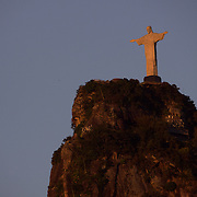 The iconic Cristo Redentor, Christ the Redeemer statue   is lit by the early morning sunrise atop the mountain Corcovado. The Christ statue was voted one of the seven wonders of the modern world in 2007. It was designed by Brazilian Heitor de Silva Costa and was inaugurated in 1931 having taken years to assemble. Rio de Janeiro, Brazil. 23rd July 2010. Photo Tim Clayton..