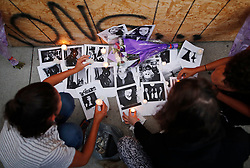 People light candles and leave photos of 18-year-old victim Reese Fallon at a memorial remembering the victims of a shooting on Sunday evening on Danforth, Ave. in Toronto, ON, Canada, on Monday, July 23, 2018. Photo by Mark Blinch/CP/ABACAPRESS.COM