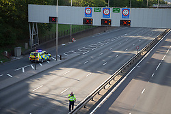 © Licensed to London News Pictures. 17/07/2020. London, UK. A Police have closed the A102 Blackwall Tunnel Southern Approach. Police negotiators are speaking to a man who is on the ledge of a bridge that passes over the A102 .   Photo credit: George Cracknell Wright/LNP