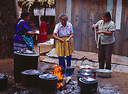 Women in Carla's Camp cooking frybread over an open fire, Carla Goseyun's White Mountain Apache Traditional Sunrise Ceremony, July 7-9, 1990, Whiteriver, Arizona.  Please Note: A small extra licensing fee needs to be paid to the Goseyun Family for usage of this photo. Contact Fred Hirschmann for more information. Thanks.