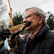 A man holding a crucifix takes part on a anti-abortion rally throughout Dublin City centre, on March 10, 2018.