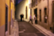 narrow alley with people out of focus