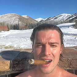 """Patrick Schwarzenegger releases a photo on Instagram with the following caption: """"Jacuzzi. Cigar. Mountains. Few my fav things. hope you\u2019re enjoying few ur fav things as the year closes out. Happy New Year! \ud83c\udf8a God bless."""". Photo Credit: Instagram *** No USA Distribution *** For Editorial Use Only *** Not to be Published in Books or Photo Books ***  Please note: Fees charged by the agency are for the agency's services only, and do not, nor are they intended to, convey to the user any ownership of Copyright or License in the material. The agency does not claim any ownership including but not limited to Copyright or License in the attached material. By publishing this material you expressly agree to indemnify and to hold the agency and its directors, shareholders and employees harmless from any loss, claims, damages, demands, expenses (including legal fees), or any causes of action or allegation against the agency arising out of or connected in any way with publication of the material."""