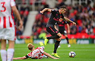 Granit Xhaka of Arsenal battles with Darren Fletcher of Stoke city. Premier league match, Stoke City v Arsenal at the Bet365 Stadium in Stoke on Trent, Staffs on Saturday 19th August 2017.<br /> pic by Bradley Collyer, Andrew Orchard sports photography.