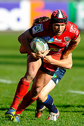 Toulon Inside Centre (#12) Matt Giteau is tackled during the second half of the match - Photo mandatory by-line: Rogan Thomson/JMP - Tel: Mobile: 07966 386802 21/10/2012 - SPORT - RUGBY - Cardiff Arms Park - Cardiff. Cardiff Blues v Toulon (RC Toulonnais) - Heineken Cup Round 2